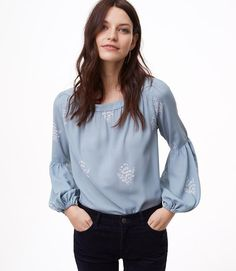 Lantern sleeves and delicate florals shape this flowy top with a flattering silhouette