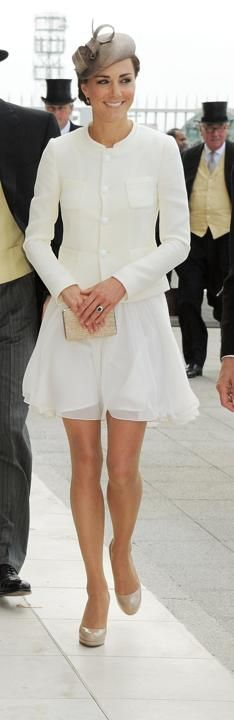 June 4, 2011 - A short, white Reiss dress fluttered out from beneath a buttoned-up Joseph coat at a derby festival in England, but the then-newlywed still looked ladylike.