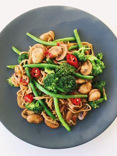 Wok with teriyaki noodles, mushrooms, broccoli and chili