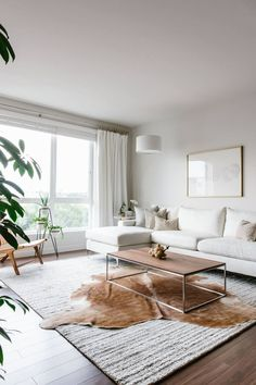 """Spotted on Downshiftology: """"Take a tour of my modern and minimalist living room. My interior design style is a blend of minimalism, mid-century modern, Scandinavian and SoCal vibes."""""""