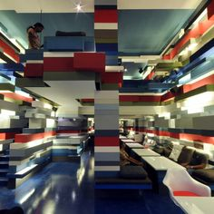 Lego-like blocks are stacked along the walls of this cafe in Chennai by Indian studio Mancini Enterprises.