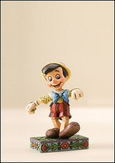 "Heartwood Creek by Jim Shore Disney Traditions  Pinocchio: ""Lively Step""  Specifications   Height : 4.5""  Materials : Stone Resin.    Your Price: $14.95"