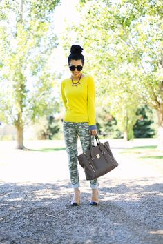 Try the unexpected today with a neon sweater and camo pants. Cap toe heels dress up the look nicely.
