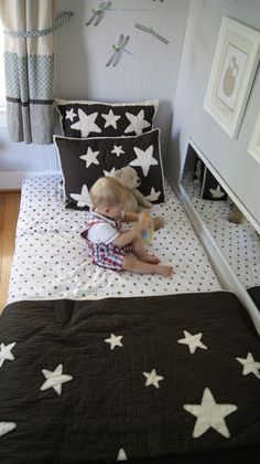 My Kid Sleeps on the Floor: Montessori Floor Bed - The Sprouting Seed. Floor bed, maybe. Like the mirror on its side Montessori Baby, Montessori Bedroom, Maria Montessori, Baby Bedroom, Kids Bedroom, Room Baby, Toddler Rooms, Kids Sleep, Baby Decor