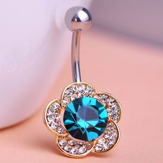 Beautiful Flowers Piercing (Belly Button Ring) Item Type: Body Jewelry Fine or Fashion: Fashion Style: Trendy Body Jewelry Type: Navel & Bell Button Rings Material: Rhinestone Metals Type: Stainless S