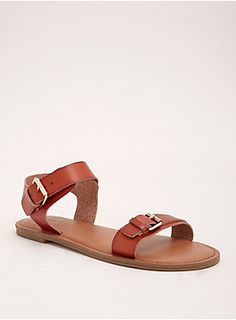 """You'll be living in these flat sandals come summertime, thanks to the goes-with-anything cognac faux leather straps and the gleaming gold tone buckles.<div><ul><li style=""""list-style-position: inside !important; list-style-type: disc !important"""">TRUE WIDE WIDTH: Designed so you never have to size up again.</li><li style=""""list-style-position: inside !important; list-style-type: disc !important"""">Man-made materials</li><li style=""""list-style-position: inside !important; list-style-type: disc…"""