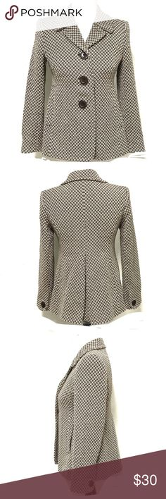 Love at first sight. Cutest Ann Taylor blazer ever black and cream patterned rich substantial fabric. Fitted bodice to just below the chest. Relaxes with a gentle a-line shaped. The back has a single large pleat. It is fully lined. Size is generous for an xs petite in my opinion Ann Taylor Jackets & Coats Blazers