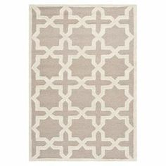"Anchor your dining set or living room seating group with this lovely hand-tufted wool rug, showcasing a geometric trellis motif.  Product: RugConstruction Material: WoolColor: BeigeFeatures:  Made in IndiaHand-tuftedPile Height: 0.63"" Note: Please be aware that actual colors may vary from those shown on your screen. Accent rugs may also not show the entire pattern that the corresponding area rugs have.Cleaning and Care: Professional cleaning recommended"