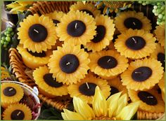 "Sunflowers are cheerful, colorful, long -burning and perfect for a classy ""country"" wedding reception table centerpiece display of dazzling candlelight. Made by Armadilla Wax Works since 1971."