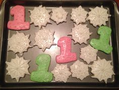Snowflake and #1 sugar cookies iced with royal icing