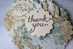 Map favor tags, 25, with hand-stamped thank you message, vintage atlas design, perfect for travel theme party or destination wedding. $12.50, via Etsy.