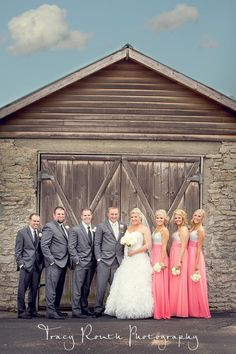 Wedding Party. Grey suits and coral bridesmaids dresses.