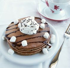 Add hot cocoa mix to your pancakes to make this breakfast.