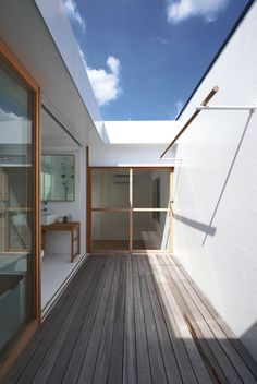 Ipe deck. Ceiling to eave continuous plane.   Tato Architects