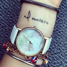 "Wrist tattoo saying ""Ad maiora"" on Kate, which means ""towards greater"" in Latin."