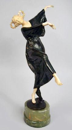 Dancer by Bruno ZACH. A patinated bronze and ivory sculpture on a onyx base by Bruno Zach depicting a dancer. Made in Austria Circa: 1930 Signature: Zach  Dimensions:  16 in. H (hva)