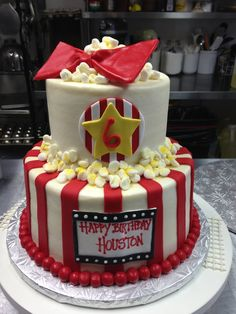 Movie theater themed birthday cake! Made with both butter cream icing and fondant décor.