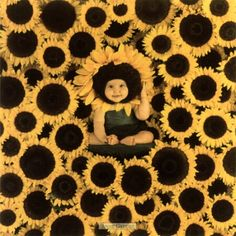 """Anne Geddes. When I still lived """"at home"""" (my parent's house), I redecorated my bedroom with a sunflower theme (my fave flower) I have several Anne Geddes shots in frames, including this one, that I hung on the wall. The bedroom is still decorated that way"""