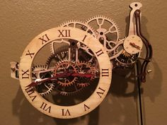 One of Brian Laws wooden clocks.  Laser cut wooden clock.  Below is the finished clock. Here are some pictures of the process…