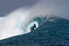 Brazilian professional surfer Santos dies after being shot...  Brazil's Ricardo Dos Santos competes at the Billabong Pro Tahiti in the southern Pacific ocean island of Tahiti, French Polynesia, on Aug. 26, 2012.