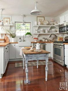 This small country kitchen certainly doesn't lack rustic charm. This small country kitchen certainly doesn't lack rustic charm. White cabinets topped with wood countertops and a beaded. Small Country Kitchens, Cottage Kitchens, Modern Farmhouse Kitchens, Farmhouse Kitchen Decor, Kitchen Country, Farmhouse Style, Kitchen Interior, Eclectic Kitchen, Farmhouse Sinks