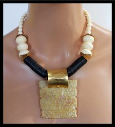 Love the bail - JADE ELEGANCE - Handcarved Jade Pendant - Restructured Amber - African Vulcanite Necklace by - sandrawebsterjewelry on Etsy Bead Jewellery, Beaded Jewelry, Jewelery, Jewelry Necklaces, Beaded Necklace, Bracelets, Tribal Jewelry, Chunky Jewelry, Statement Jewelry