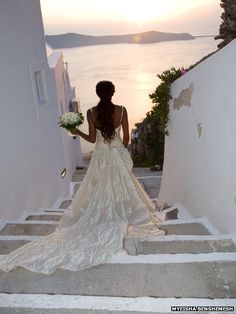 "Myeisha Benshemesh: ""Heading down the steep steps to get married, along the classical white-washed dwellings of Santorini, Greece."""