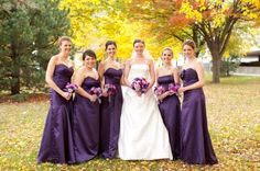 Beautiful deep purple dresses with matching bouquets.  Malone wedding, photo by Gallery 9 North.