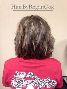 Short, brunette bob with mocha lowlights and a few blonde highlights