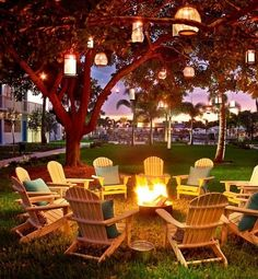 Outdoor seating...I just love everything about this, the seating, fire pit, and the hanging lanterns.