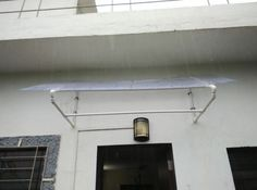 PVC Canopy on Door/window; I'd like to adapt something like this to make the balcony overhang