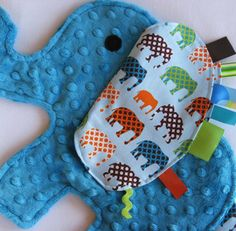 Elephant Blanket  This is so adorable. want to make Tyler a minky and tab blanky some time.