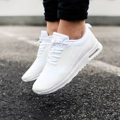 Nike Women's 'Ivory White' Air Max Thea Sneaker Premium mesh reinvention of the classic Air Max Thea sneaker by Nike with sleek, low-profile uppers. Supported on light weight phylon soles embedded with Air Max technology for enhanced shock absorption. Finished with a removable insole, textured outsoles & branding at the sides + heels. Content & Care - Mixed, rubber - Spot clean - Imported Size - Runs 1/2 size small Pic 2-4 photographed by me. Item's colour may vary from photos. Box has n...