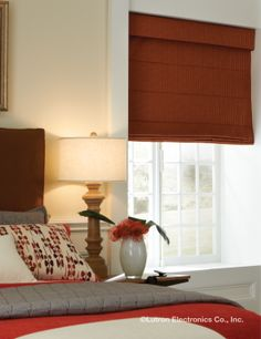 Motorized, Lutron Roman shades are beautiful and convenient. www.lutron.com/shades