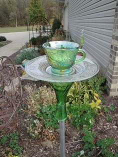 This is a green tea cup bird feeder with designed out of green glass tea cup, clear glass plate, and a green bud vase. Ground rod not included in sale.