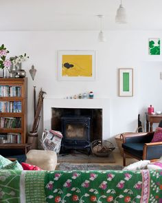 this is a beautiful room that does not seem to have been driven by a color palette (yes, the green and yellow artwork echoes the bright throw, but there are plenty of other objects and colors in the mix. so it looks lived rather than decorated.)