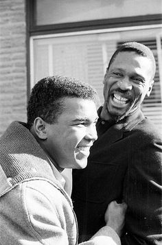 Muhammad Ali and Boston Celtics Bill Russell Heavyweight Boxing: Closeup portrait of Muhammad Ali (L) laughing with Boston Celtics Bill Russell outside of Russell's restaurant, Slade's Original Barbecue. Boston, MA 11/5/1964 CREDIT: Fred Kaplan