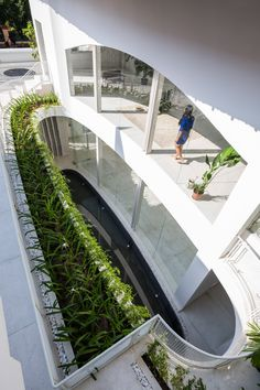Kientruc O introduced the lightwell between the buildings to provide the residents with an outdoor space secluded from the busy city road that runs along the front.