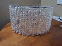DIY crystal wedding cake stand -- beautiful especially when lit