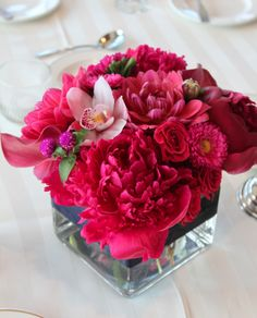 Love a good cube arrangement! Beautiful peonies, ranunculus, orchids, asters and gomphrena. #wedding #centrepieces #decor #flowers