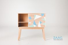 HANDMADE cabinet with rotating door.Available in several wood pieces / color patterns.