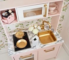 In this post I am transforming the Ikea Duktig play kitchen using some Colourtrend satin paint in the shade Beag, some Rustoleum bright gold spray paint and some marble contact paper to give it a fun modern girly makeover. A really fun Ikea hack to try for your children