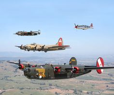 "B24J Consolidated Liberator bomber, ""Witchcraft"", Tail #252534, in a three bomber and one fighter formation."
