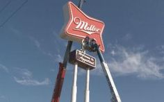An  iconic sign is moving. Kristen Distributing has taken down their Miller High Life Sign in College Station.