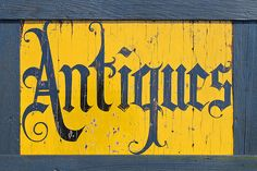 Love this lovely yellow #antiques sign.