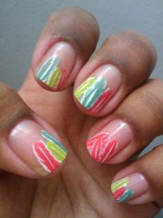 Neon teal, chartreuse, and pink feather nails.