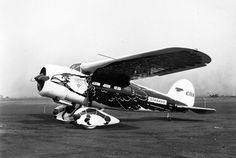 Standard Oil's Lockheed Vega, painted as an eagle, sits quietly on the ramp.