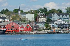 Lunenburg, Nova Scotia - A colorful sample of maritime life in Canada. Well-preserved 18th-century British-Colonial-style buildings, part of a UNESCO World Heritage site, sit close together in a community originally designed around the offshore Atlantic fishery. Old salts still work a big fleet of deep-sea trawlers, and one of North America's largest fish processing plants is based here.  -One of my favorite places.