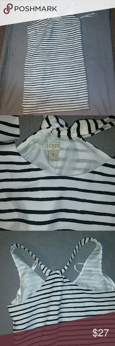 J Crew black and white stripped dress Adorable racer back dress from J crew. Goes to the knee. Only worn once. Super comfortable soft, light material. Feel free to make an offer! J. Crew Dresses Midi