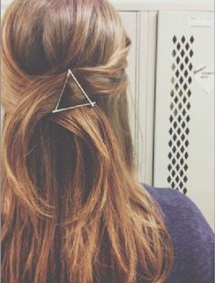 Bobby Pins. Use a few bobby pins (preferably one that doesn't match your hair color) and create a geometric graphic in your hair- wavy side down of course.   -8 Hair Accessories And Easy Styling Tips For A Bed-head To A Top Knot Bun | Nubry - San Diego's #1 Fashion, Beauty, Events And Lifestyle Blog - What To Wear, Insider Tips, & Celebrity Trends